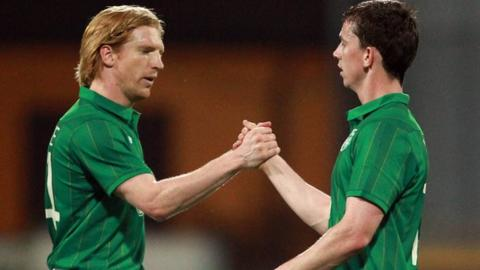 Paul McShane and Kevin Foley shake hands at the end of the friendly against a Tuscan Select