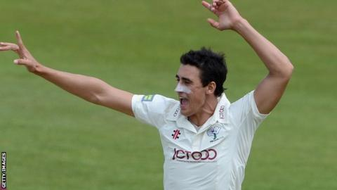 Mitchell Starc celebrates a wicket for Yorkshire