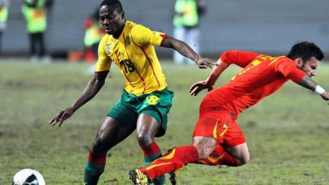 Cameroon's Enoh Eyong (in yellow)