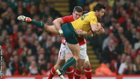 Wales' Scott Williams tackles Australia's Adam Ashley-Cooper