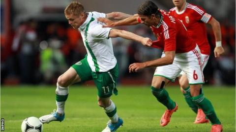 Damien Duff of the Republic of Ireland in action against Hungary's Peter Halmosi