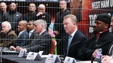 Dereck Chisora, Frank Warren and David Haye sit amongst others at the fight press conference at Upton Park