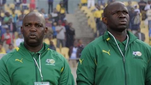 Former South Africa coach Pitso Mosimane (left) and interim boss Steve Komphela