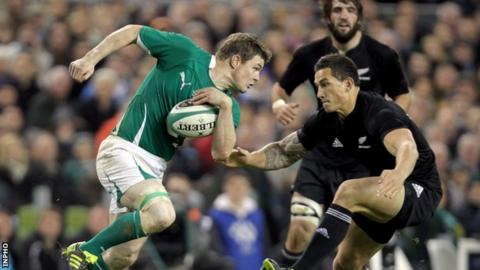 Brian O'Driscoll is about to be tackled by Sonny Bill Williams in 2010