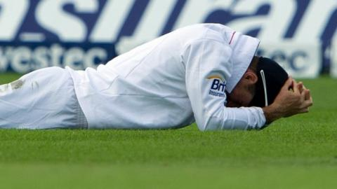 Andrew Strauss reacts after dropping a catch