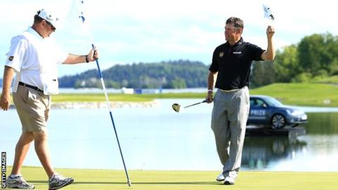 Lee Westwood with his new putter celebrating victory in Sweden