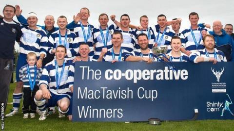 Newtonmore celebrate their MacTavish Cup win