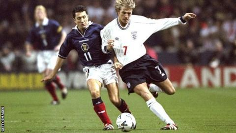 John Collins and David Beckham battle for the ball in 1999