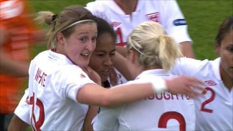 Rachel Yankey is congratulated by her team-mates