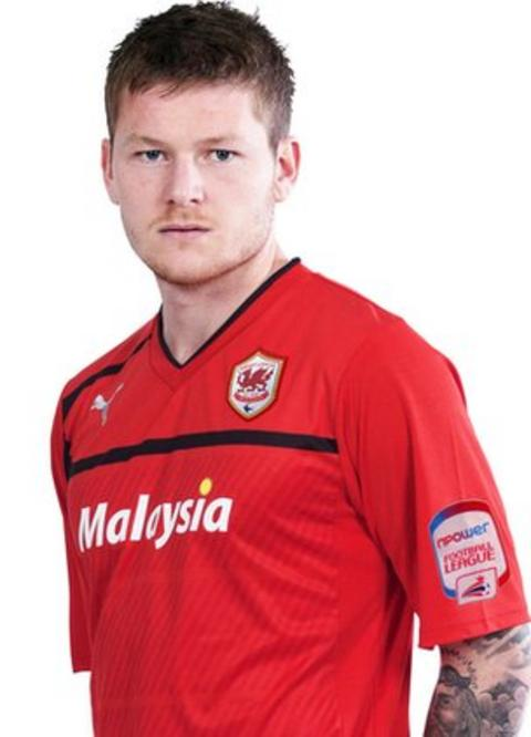 Aron Gunnarsson models Cardiff's new red kit