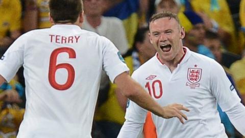 Wayne Rooney celebrates scoring against Ukraine