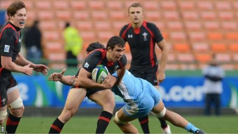 Wales scrum-half Tom Habberfield tests the Argentina defence