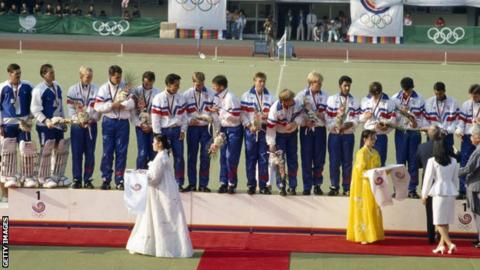 GB men's field hockey team on the podium in Seoul. Veryan Pappin is second left.