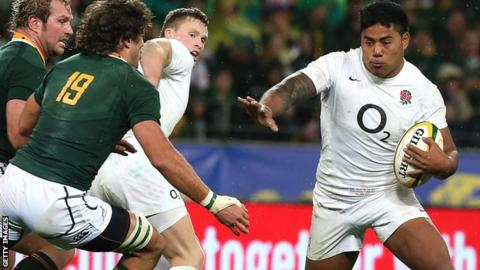 England centre Manu Tuilagi takes on the South Africa defence