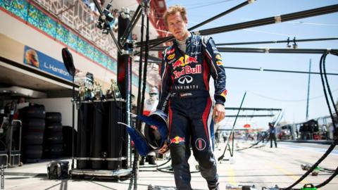 Sebastian Vettel arrives back in the pits having retired from the European GP in Valencia