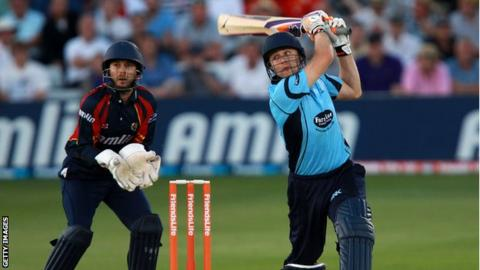 Luke Wright of Sussex hits out with James Foster of Essex looking on during the Friends Life T20 match between Essex and Sussex