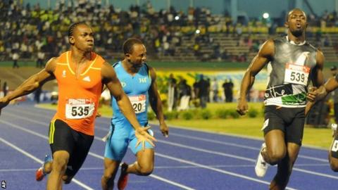 Yohan Blake (left) celebrates after crossing the finish line ahead of current world-record holder Usain Bolt (right)