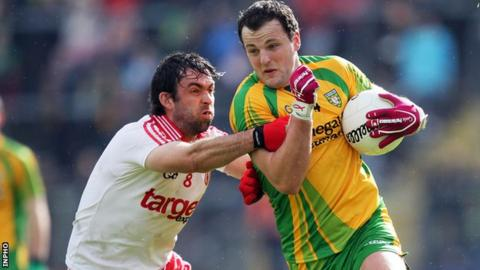 Joe McMahon of Tyrone challenges Donegal's Michael Murphy