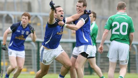 Eugene Keating celebrates with Niall Smith after scoring Cavan's third goal against Fermanagh