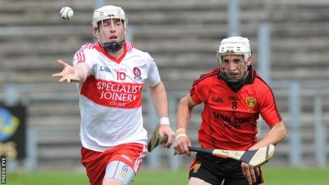 Derry's Paddy Henry in action against Andy Savage of Down in the Ulster hurling semi-final
