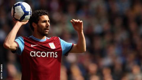 Carlos Cuellar takes a throw in for Aston Villa