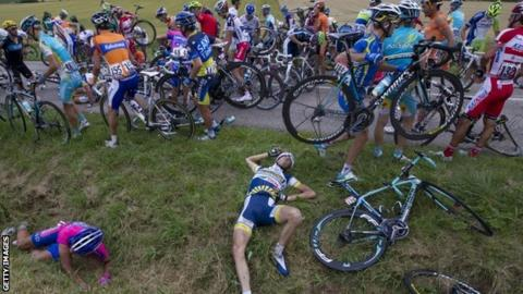 Wouter Poels (centre on grass) after the crash on stage six of the Tour de France
