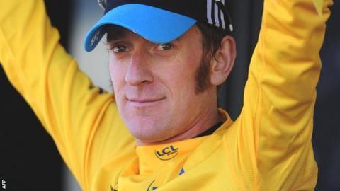 Bradley Wiggins dons the yellow jersey after stage seven