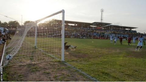 South Sudan's Richard Justin scores a penalty against Uganda
