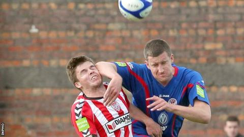 Derry debutant Conor Murphy battles with Jason McGuinness