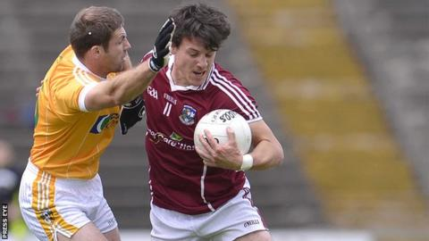 Antrim's Tony Scullion challenges Sean Armstrong of Galway