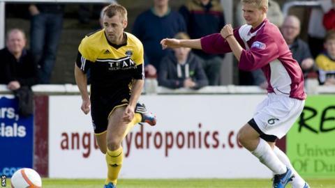 New signing McGinn beats Arbroath's Michael Travis