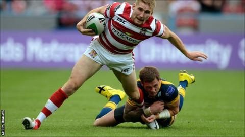 Wigan's Sam Tomkins is tackled by Zak Hardaker of Leeds during Saturday's Challenge Cup semi-final