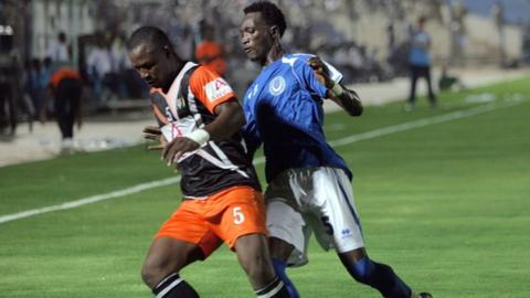 Sudanese club Al-Hilal player Alaa Eldin Yousif Kano (right) vies for the ball against Djibril Moussa of Niger's club AS FAN