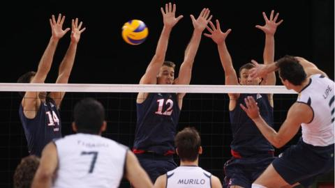 The USA and Brazil men's volleyball teams in action