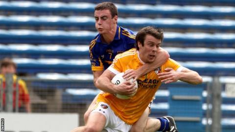 Tipperary's Alan Campbell challenges James Loughrey