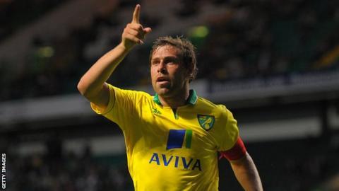 Grant Holt celebrates his winning goal at Parkhead