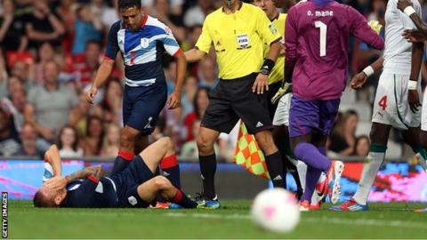 Neil Taylor looks on in concern after Craig Bellamy is flattened
