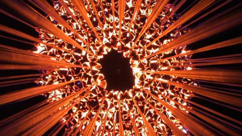 The London 2012 Olympic flame is lit by seven young athletes