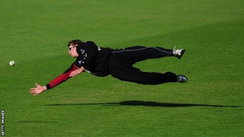 Alex Barrow diving to stop the ball against Nottinghamshire
