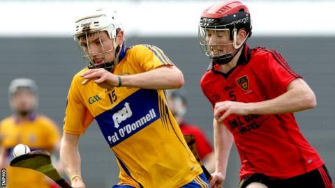 Clare's Shane O'Donnell tries to burst away from Down's Ryan Brannigan