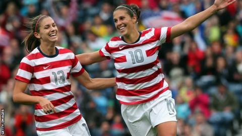 Carli Lloyd of USA [r] celebrates with team-mate Alex Morgan after scoring for the United States against Colombia