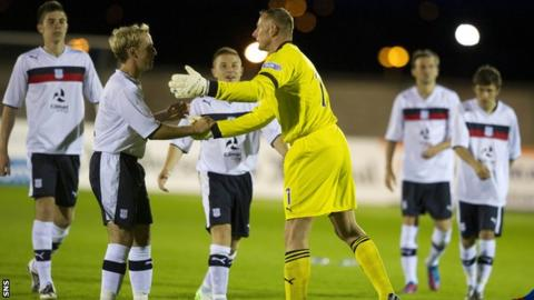 Douglas (centre) was the hero for Dundee in the penalty shoot-out