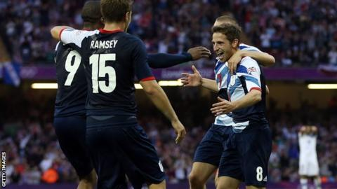 Joe Allen (right) and Aaron Ramsey celebrate Daniel Sturridge's goal