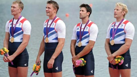 Tom James (second from right) and his Great Britain coxless four crewmates stand proudly on the podium after receiving their Olympic gold medals at Eton Dorney