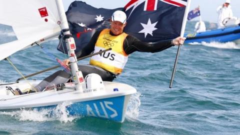 Tom Slingsby celebrates winning sailing gold for Australia