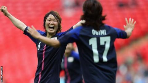 Japan's women celebrate.