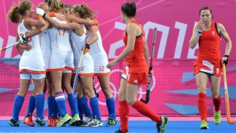 Dutch players celebrate scoring against Great Britain