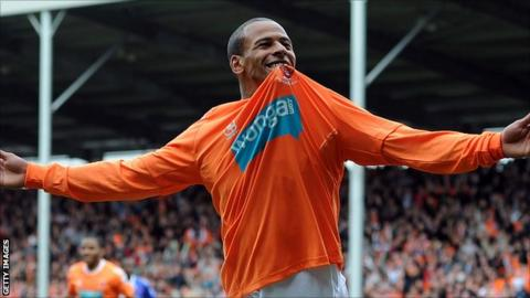 DJ Campbell celebrates scoring a goal for Blackpool in 2011