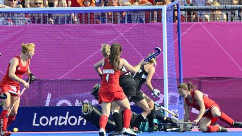 Sarah Thomas (R) scores Team GB's third goal in a 3-1 hockey win against New Zealand, a victory that secured a bronze medal for Great Britain