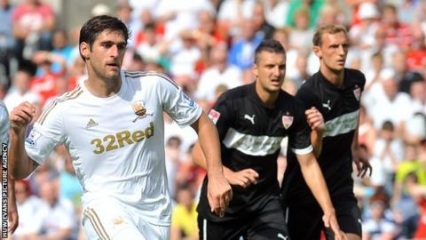 Danny Graham scores from the penalty spot